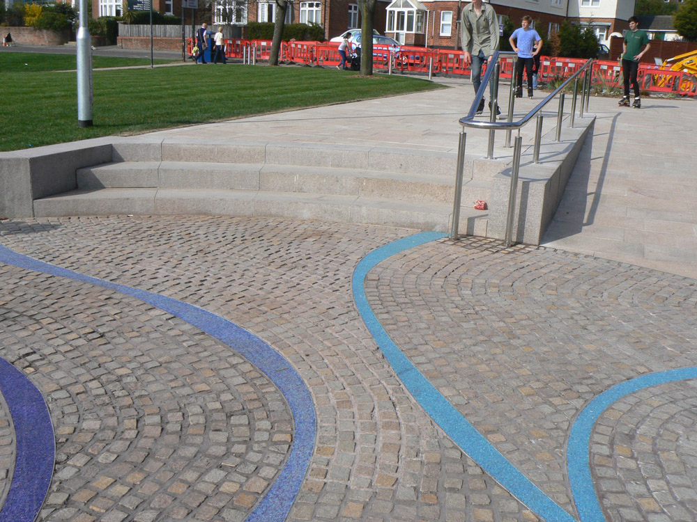 A bespoke orange mix of Porphyry Setts at Seldown Park' Poole. For further images and information on this job please visit our Projects Gallery.