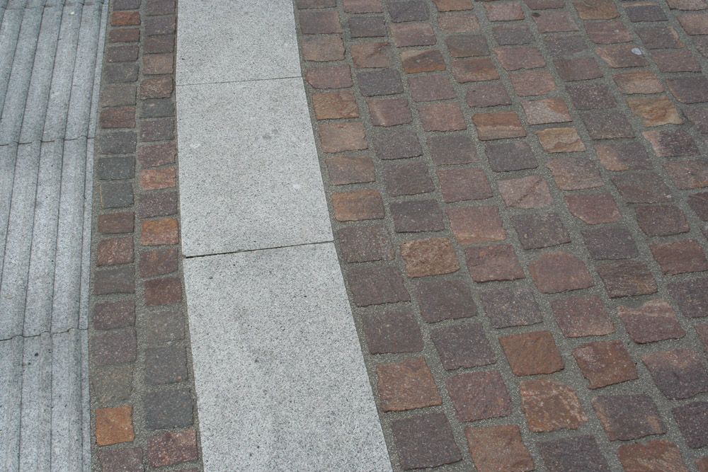 Porphyry setts and silver grey Granite paving & kerb in Widemarsh Street' Hereford. For further images and information on this project please visit our Projects-Public Spaces gallery.