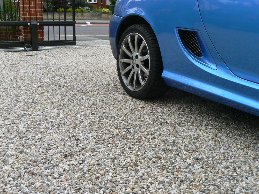 Flint gravel laid with Cedagravel®' gravel stabilisation' on a private driveway.