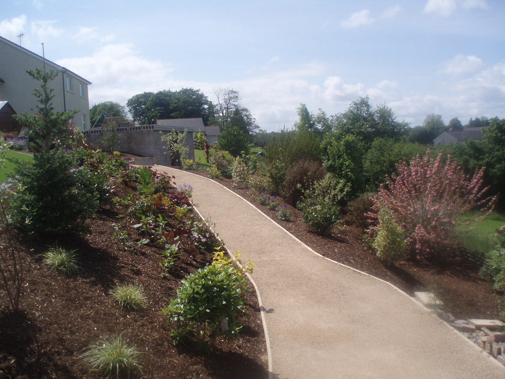 Golden amber footpath gravel. Private garden in Ireland designed and built by Maurice Maxwell Garden Designs.