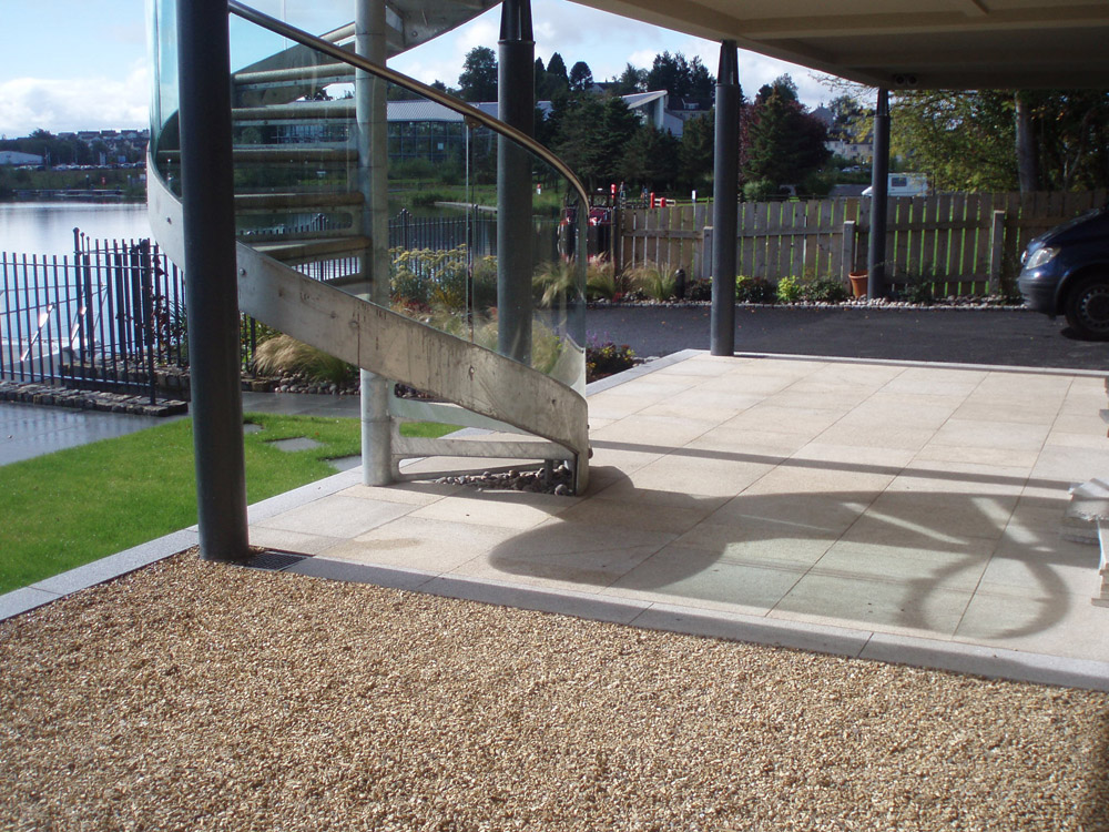 Golden flint gravel with yellow granite paving and silver grey granite kerb. Private garden' in Ireland' designed by Maurice Maxwell Garden Designs and built by Spring Landscapes. For further images of this job please visit our Projects Gallery.