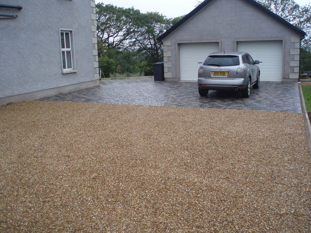 Golden flint gravel and temple setts (pictured here when wet). The golden flint gravel is supported by our stabilisation system; Cedagravel®. Private property' in Ireland' built by Sam Sayres. For further images of this job please visit our Projects-Private Places Gallery.