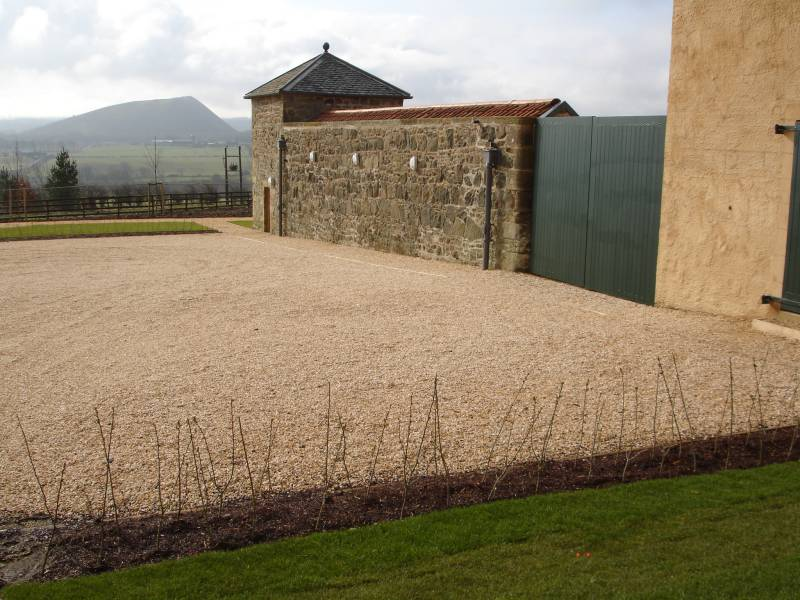 Golden quartzite aggregate laid with Cedagravel®' gravel stabilisation. Private Farm' Scotland.