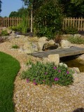 Yorkstone rockery with golden quartzite aggregate' private garden.