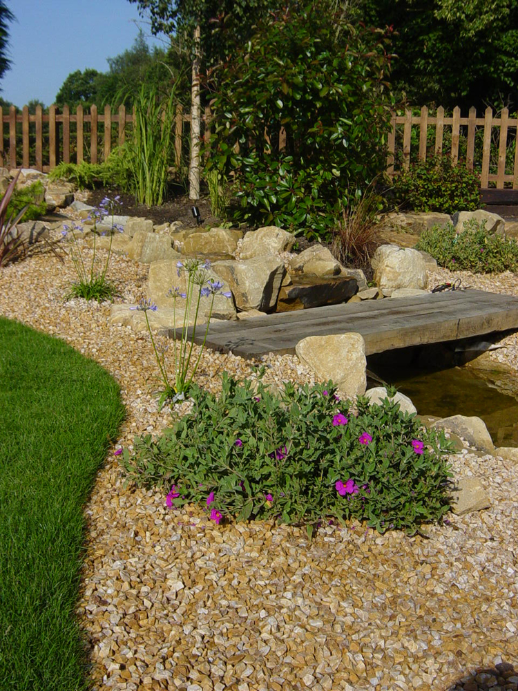 Golden Quartzite Aggregate and Rockery. Private Garden designed and built by New Eden Landscapes.