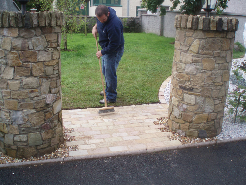 Green riven sandstone setts. Private garden' in Ireland' designed and built by Maurice Maxwell Garden Designs.