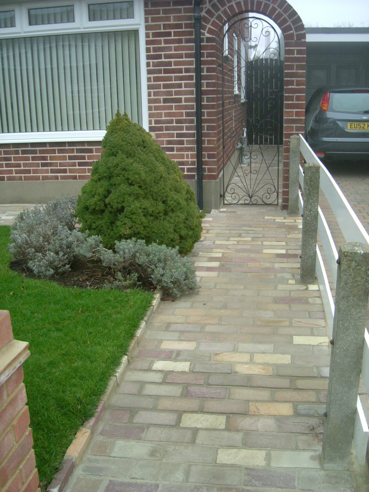 Riven Sandstone Setts 100x200x40-70mm. 80% Beige' 10% Green and 10% Pink. Designed and built by John Charles Landscapes.