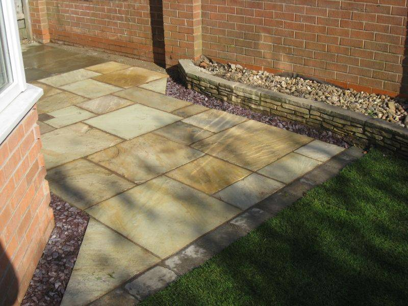 Green Riven Sandstone patio in a Private Garden