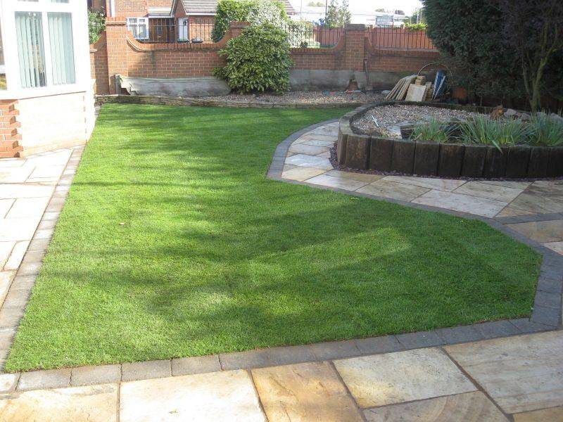 Green Riven Sandstone Paving in a Private Garden.