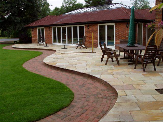 Green Riven Sandstone Paving laid to create an attractive patio area in a Private Garden.