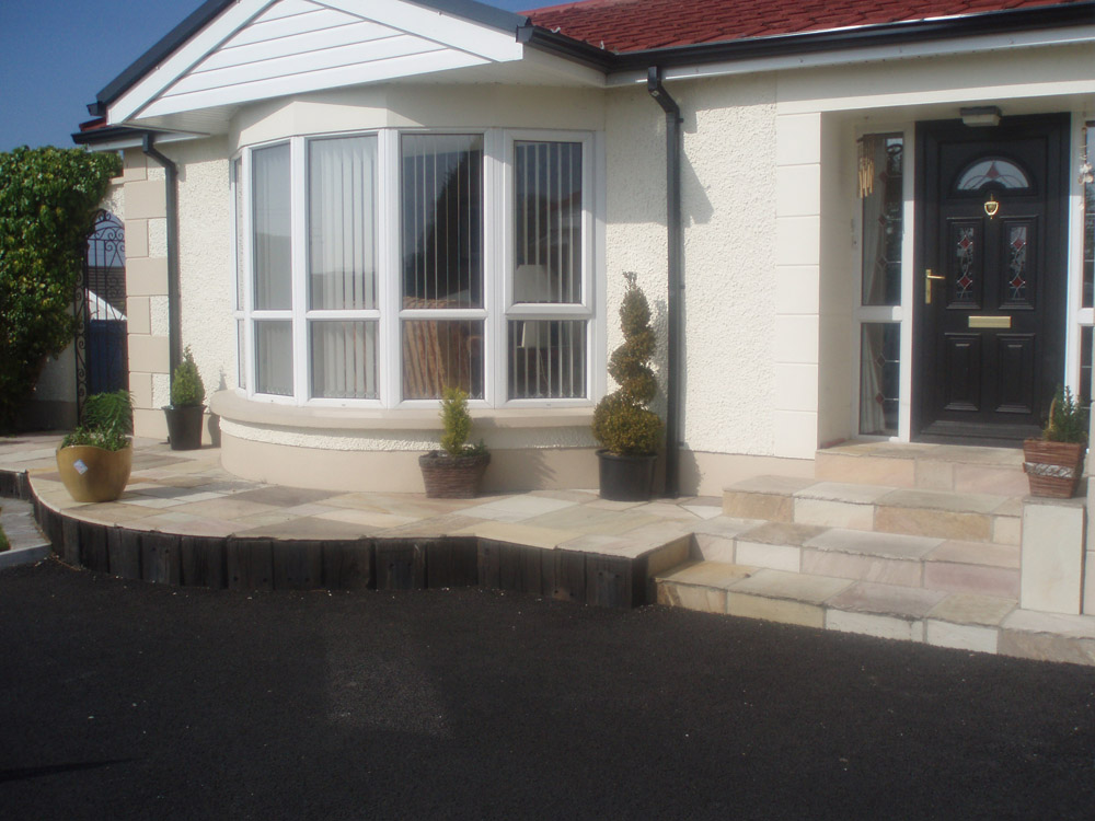 Green riven sandstone paving at the front of private house in Ireland. Designed and built by Maurice Maxwell Garden Designs.