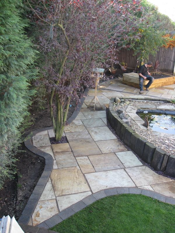 Green Sandstone Paving with a riven top surface' Private Garden.