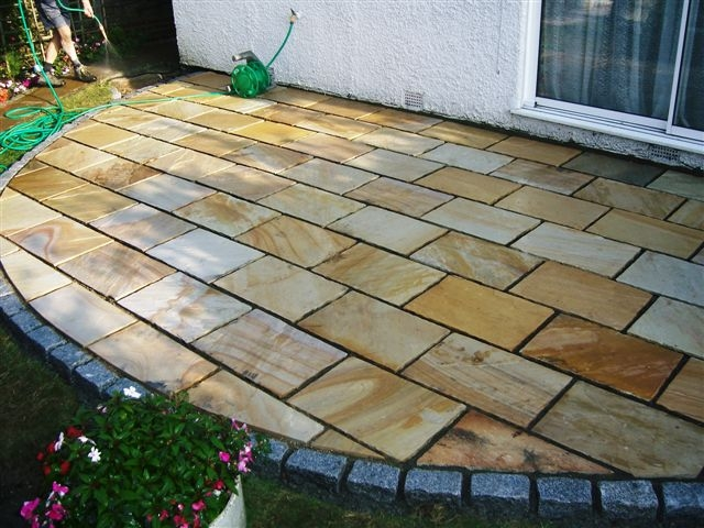 Green Riven Sandstone Paving' with silver grey granite cropped setts to edge' Private Garden Patio.