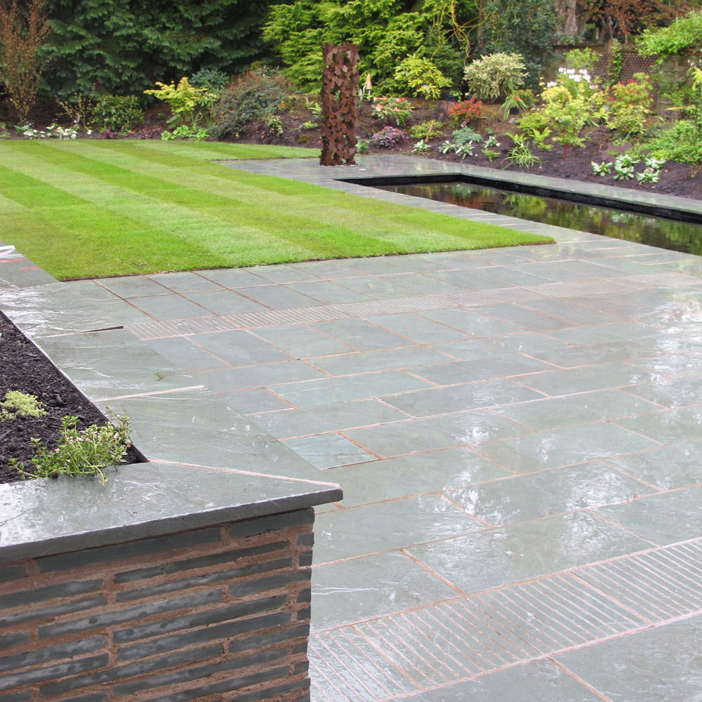Green slate paving' pictured here when wet. Private garden in Scotland by Green Edge Garden Design and Landworks Construction. For further images of this job please visit our Projects-Private Places gallery.