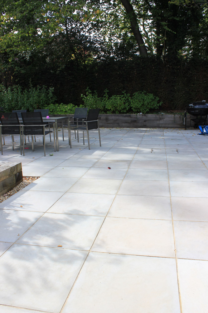 Grey sawn and sandblasted sandstone paving. Private garden designed and built by New Eden Landscapes. For further images of this job please visit our Projects-Private Places Gallery.