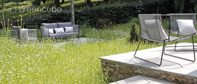 Grey sawn and sandblasted Sandstone Paving and Yellow Quartz Paddlestones. A private meadow garden by Greencube Garden and Landscape Design.