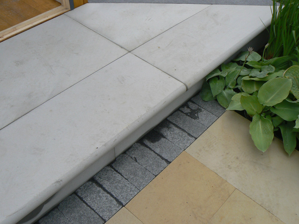 Grey sandstone step pictured here with black limestone setts and buff sandstone paving at the Balmoral Show. For further images and info of this garden please visit out Private Places-Show Gardens Gallery.