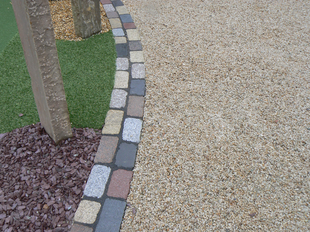 Irish barley quartzite laid in Cedagravel® at Balmoral Show. Also pictured is plum slate' golden flint gravel and temple setts. For further images and info of this garden please visit our Private Places-Show Gardens Gallery.
