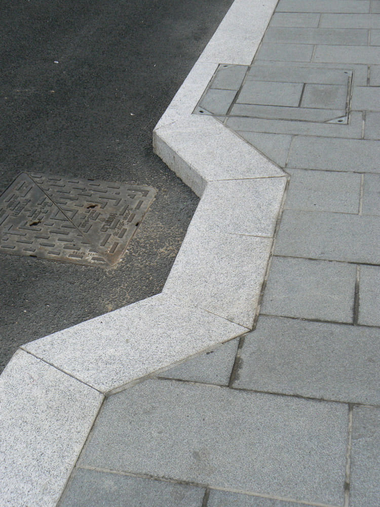 Granite kerb and setts at Dover Priory Station. For further images and information on this job please visit our Projects-Public Spaces gallery.