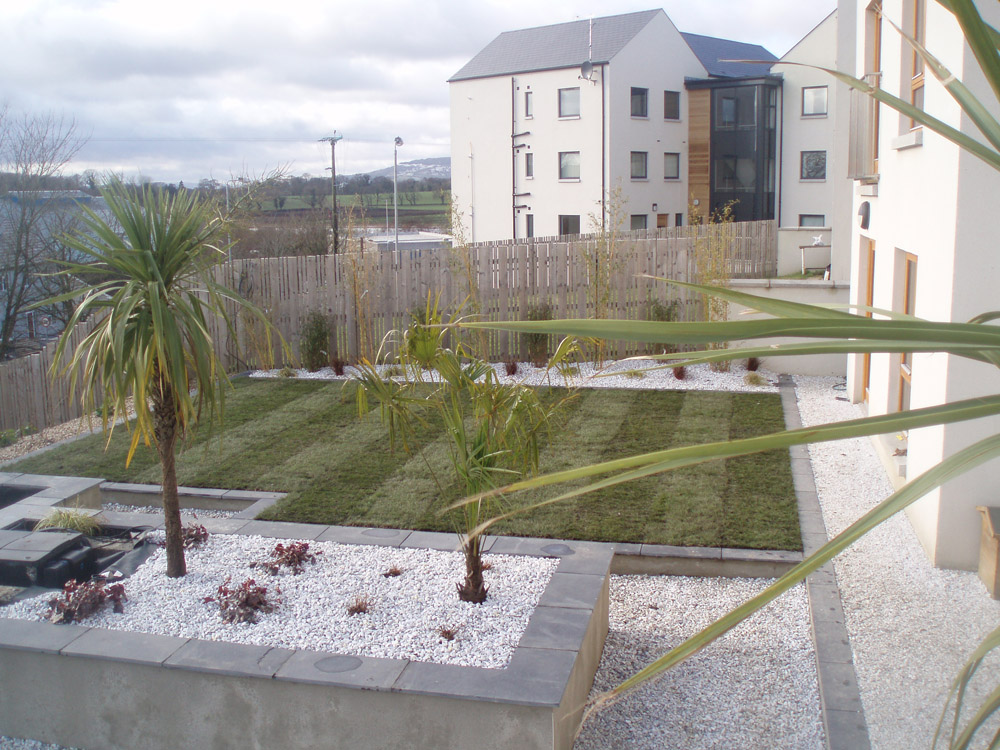Meadowgrass marble with black limestone paving and buff flint gravel. Private garden in Ireland designed and built by Maurice Maxwell Garden Designs.