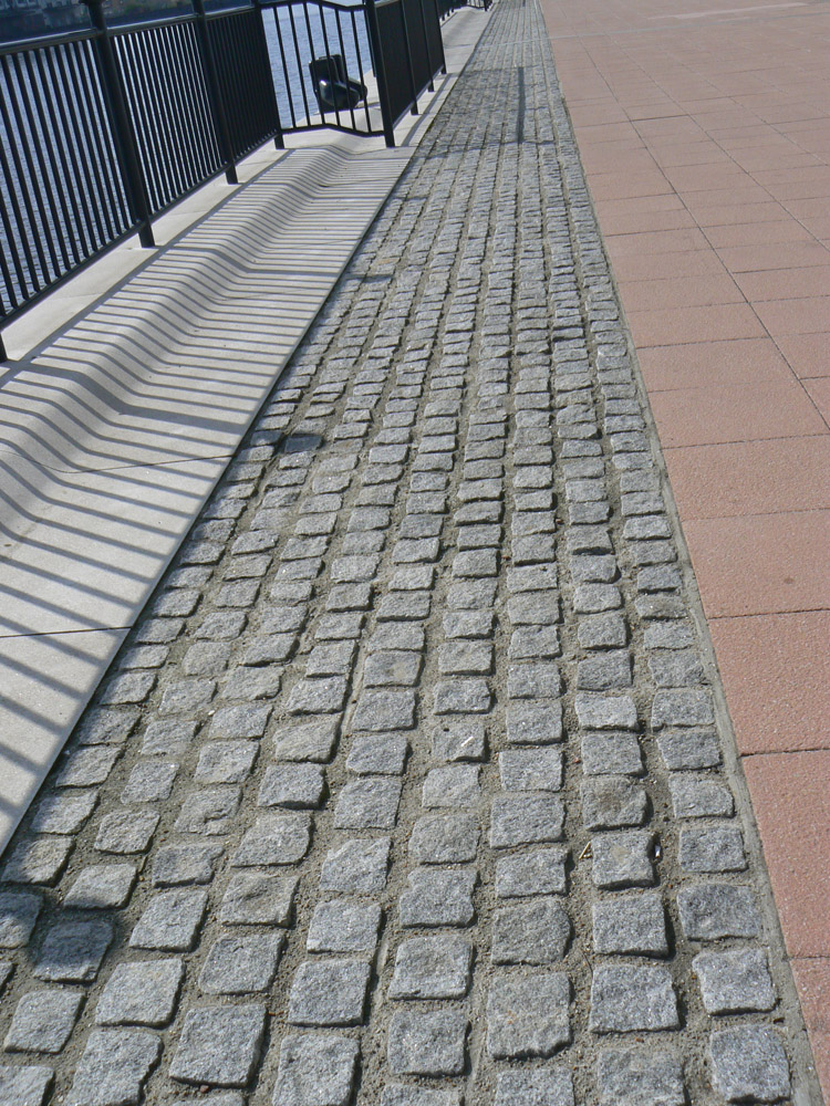 Medium grey cropped setts at Excel Hotel' London. For further images and information on this job please visit our Projects Gallery.