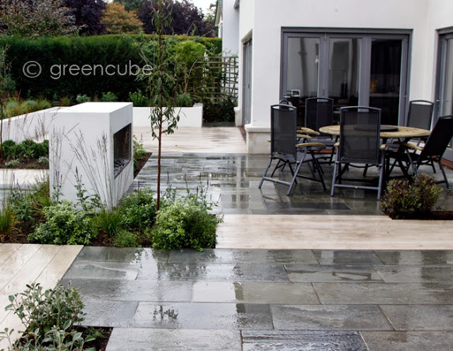Oppdal Quartzite Riven Paving' pictured here when wet' in a private garden. Designed by Greencube Garden and Landscape Design and built by Langdale Landscapes.
