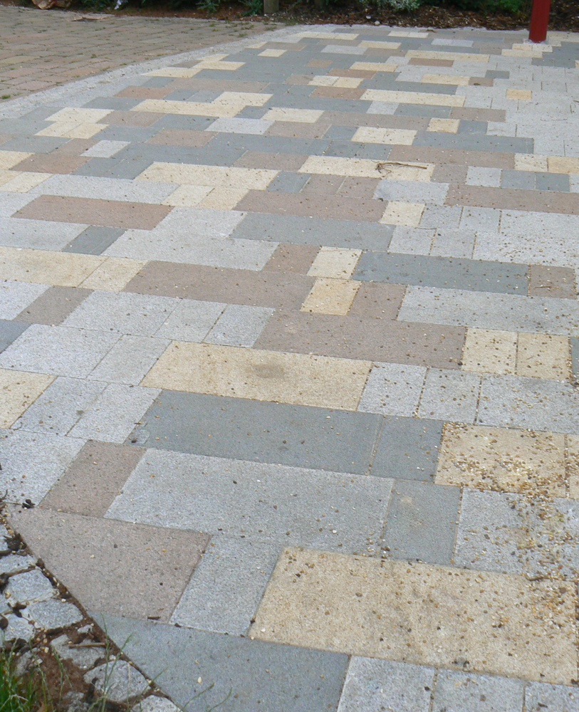 Pink granite paving with silver grey' yellow and blue grey granites. St George's Square' London. For further images and info on this job please visit our Project Gallery.