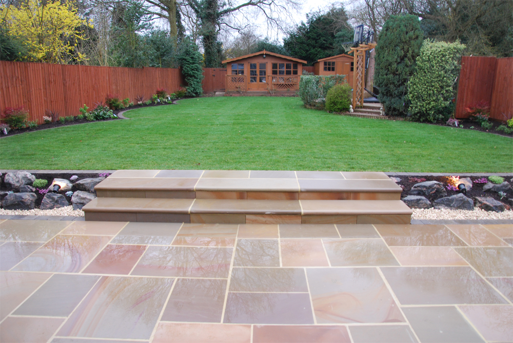 Pink Sandstone Paving and Steps' with Firebird Rockery and Tumbled Sandstone Walling. Private Garden. Contractor - Midas Touch Landscapes.