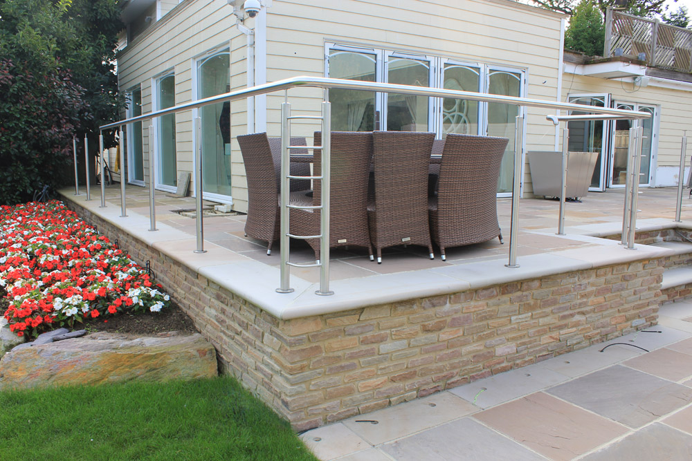 Pink sawn and sandblasted steps used in this private garden as steps and wall copings. Also pictured is beige riven sandstone paving and rustic riven sandstone setts. Garden designed and built by J. Wenman & Sons. For further images of this job please visit out Projects-Private Places Gallery.