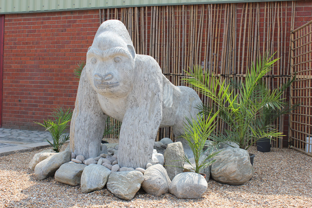 Granite gorilla ornament' ideal for use in play areas.
