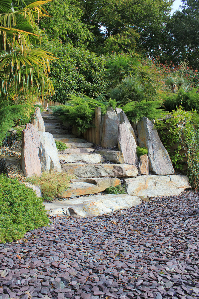 Plum slate shale and purple standing stones. Private garden designed and built by J. Wenman & Sons. For further images of this job please visit our Projects-Private Places Gallery.