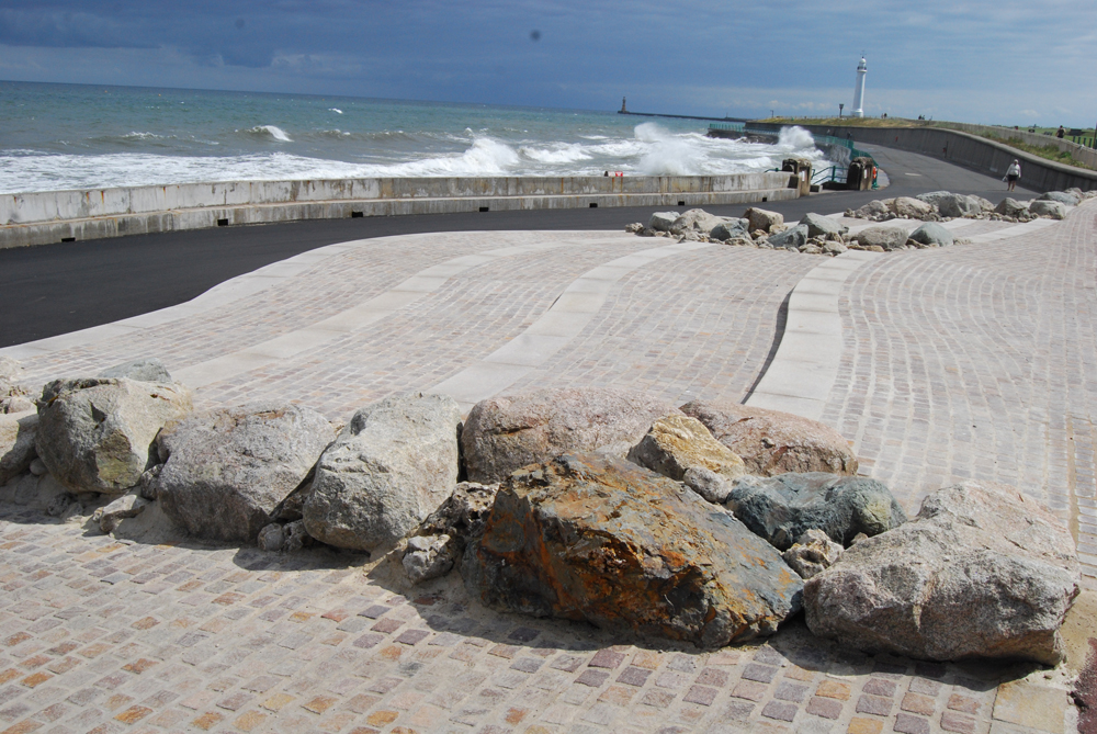 Porphyry setts' with existing boulders' at Seaburn Seafront' Sunderland. For further images and info on this job please visit our Projects Gallery.