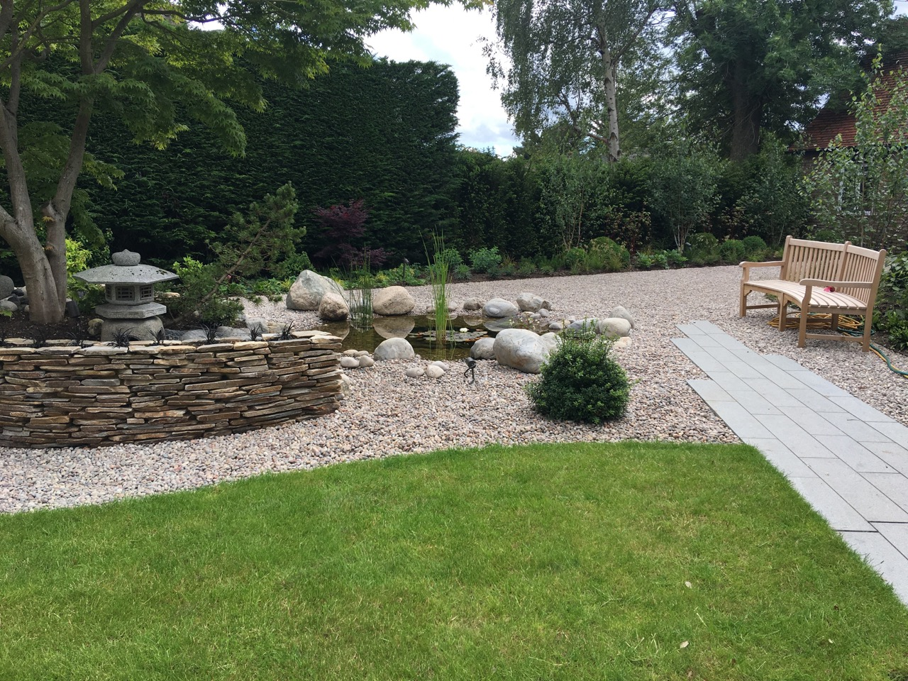 Blue Grey Granite Plank Paving, CEDAgravel and Yellow Paddlestone Walling