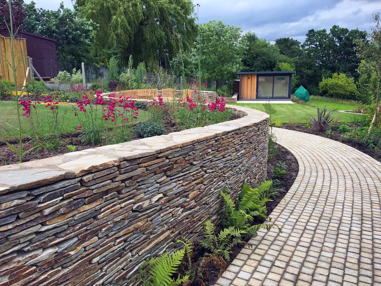 Private Garden designed by Amanda Broughton and built by Lanwarne Landscapes featuring our Yellow Paddlestones, Yellow Granite Setts and Buff Sandstone Paving.