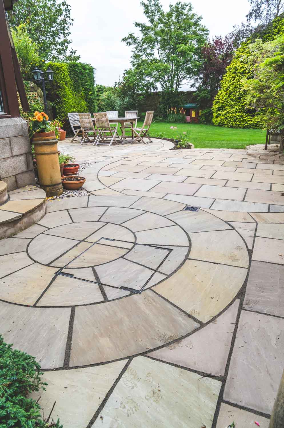 Beige riven sandstone paving in a private garden by for Garden design east lothian