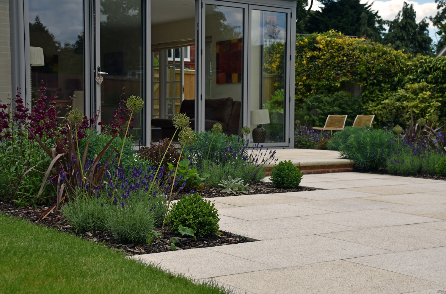 Private garden by Lisa Cox using our Yellow Granite Paving to complete the patio area.