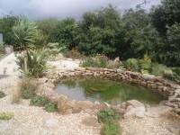 Buff Quartz Aggregate & Buff Sandstone Rockery. Both are local materials for this private garden in Ireland.