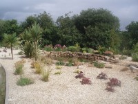 Buff Quartz Aggregate & Buff Sandstone Rockery. Both are local materials for this private garden in Ireland.