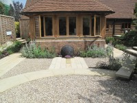 CEDAdrive® filled with Flint Gravel 10mm. Other products in this garden include Buff Sandstone Plank Paving' Yellow Quartz Paddlestones' Porphyry Setts and Golden Flint Gravel. Majestic Trees Nursery' Hertfordshire.