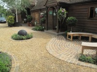 Yellow Quartz Paddlestone Walling' Buff Sandstone Plank Paving' Flint Gravel' Cedagravel' Porphyry Setts and Golden Flint Gravel. Majestic Trees Nursery' Hertfordshire.