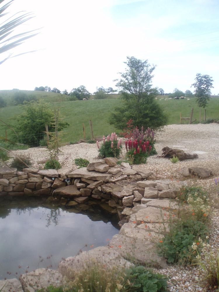 Quartz Aggregate And Sandstone Rockery In A Private Garden