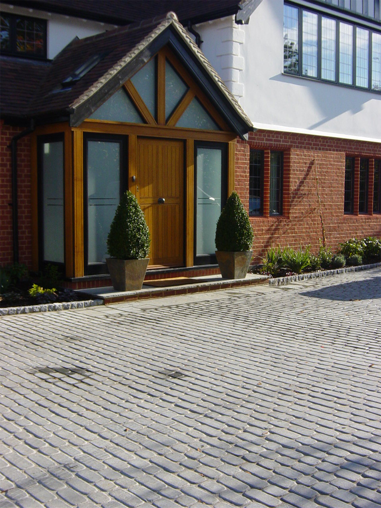 Blue Grey Temple Sett Driveway' Private House. Designed and built by New Eden Landscapes.