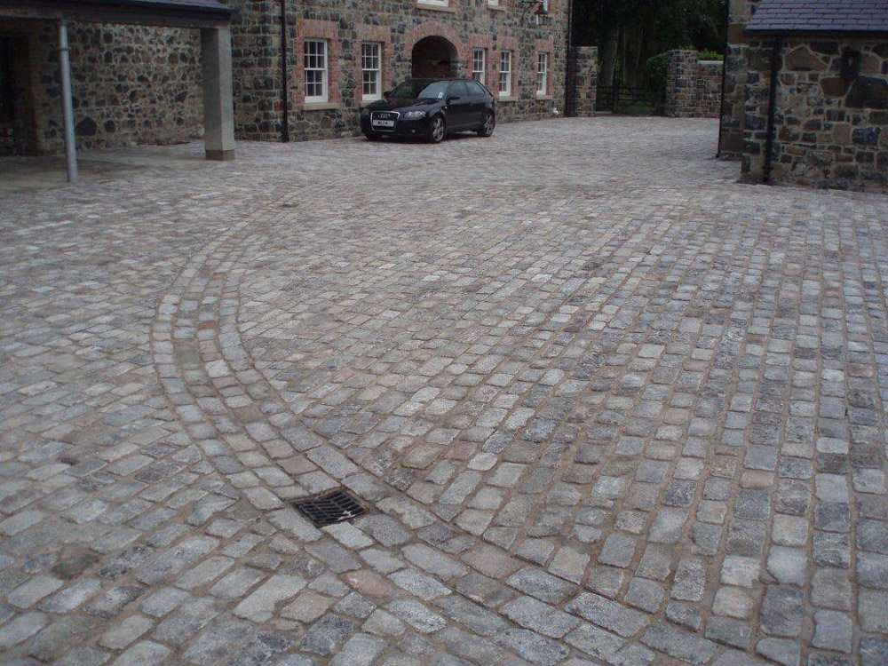 Reclaimed London Granite Setts used for a driveway at a private property in Ballymena' Northern Ireland. Designed by Beth Moore and constructed by Darren Kennedy Landscapes. For further images of this job please visit our Projects-Private Places Gallery.