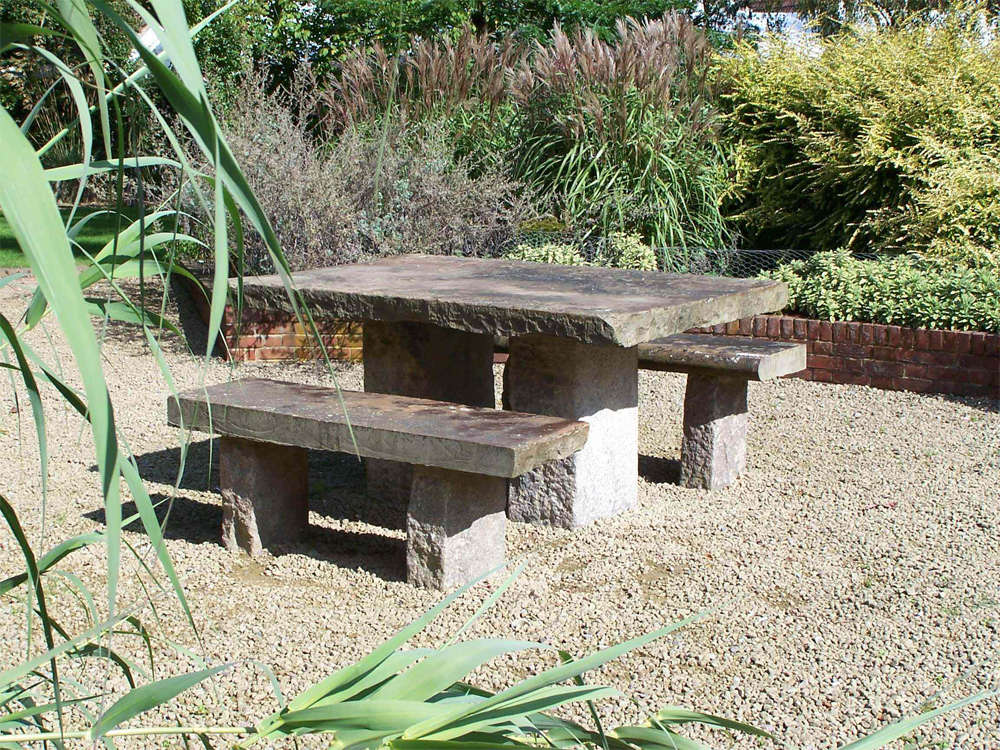 Reclaimed Yorkstone' used to create an attractive seating area in a private garden.