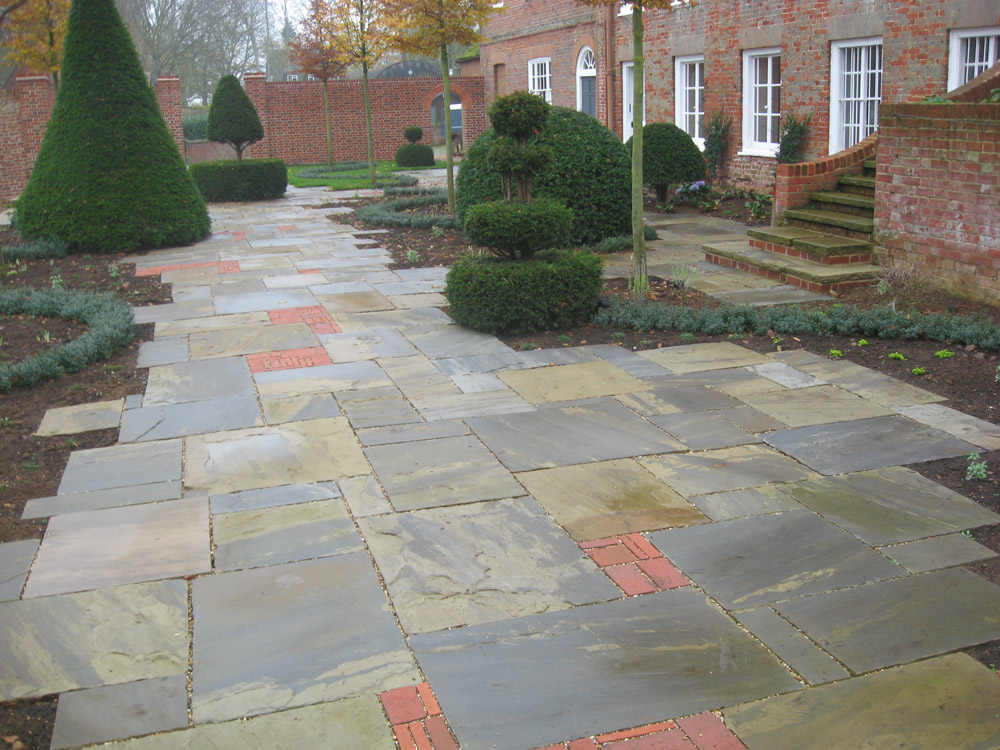 Riven yorkstone paving in a private garden. Designer - Julie Toll Ltd. Contractor - Brambledown Landscapes.
