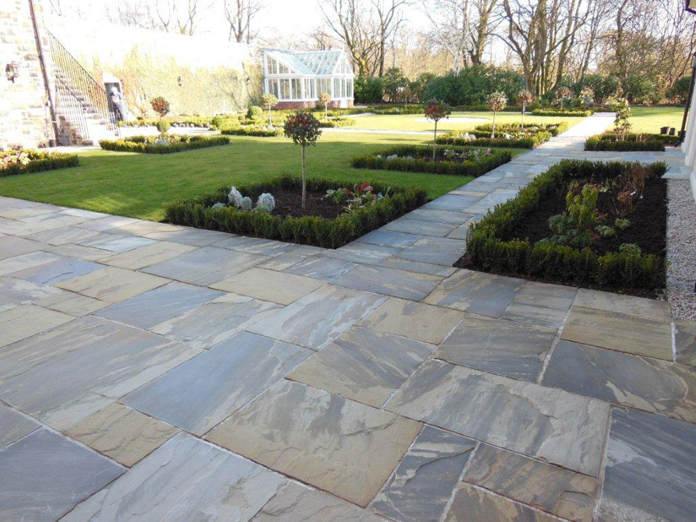 Riven Yorkstone Paving at a private property in Ballymena' Northern Ireland. Designed by Beth Moore and constructed by Darren Kennedy Landscapes. For further images of this job please visit our Projects-Private Places Gallery.