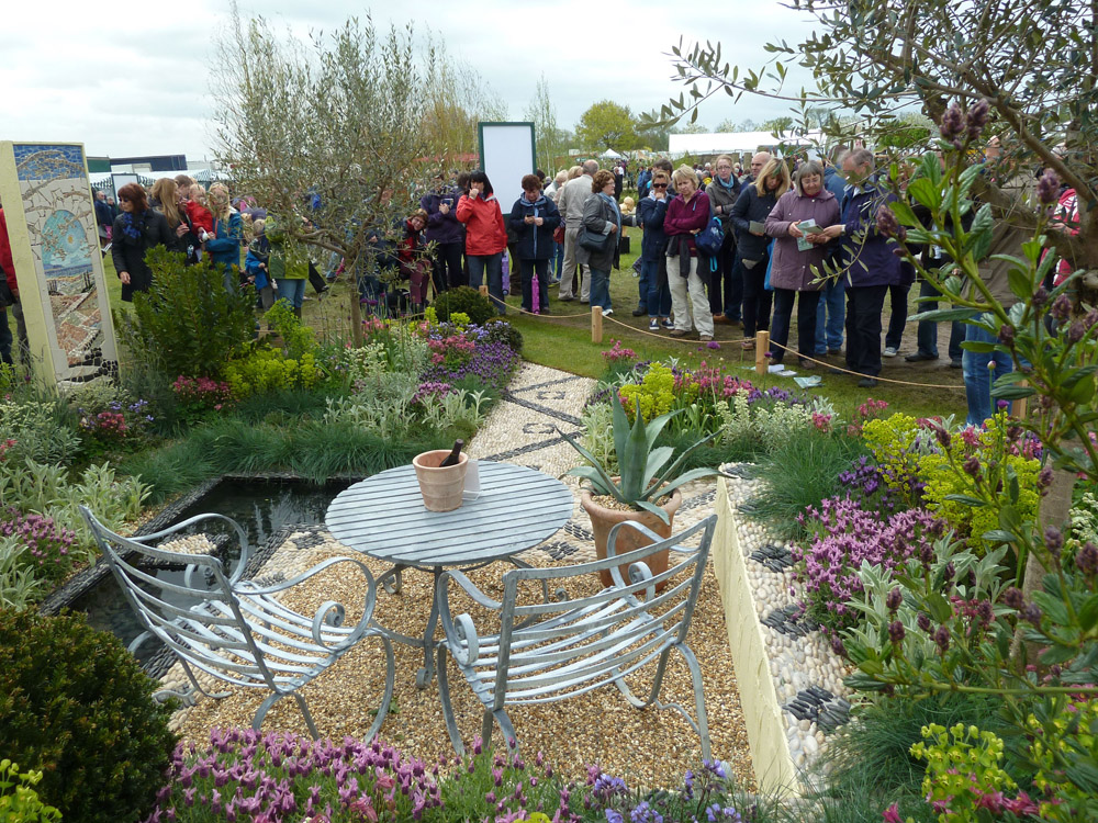 Sea Flint laid in Cedagravel at The Malvern Show 2013. Also pictured are polished black and white pebbles. Garden by Andrew Jordan Garden Design and built by Cotswold Estates & Gardens.