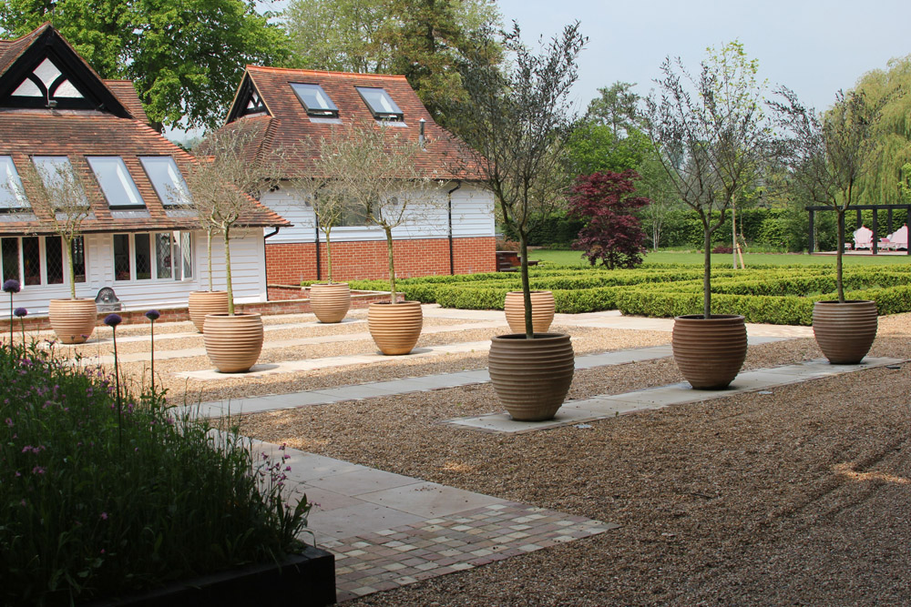 Sea Flint 10mm with Sawn Pink Sandstone Paving and Riven Sandstone Setts (a mix of all three colours; beige' green and pink). Private garden designed by Arlette Garcia and built by Gavin Jones. For further images of this job please visit our Projects-Private Places gallery.