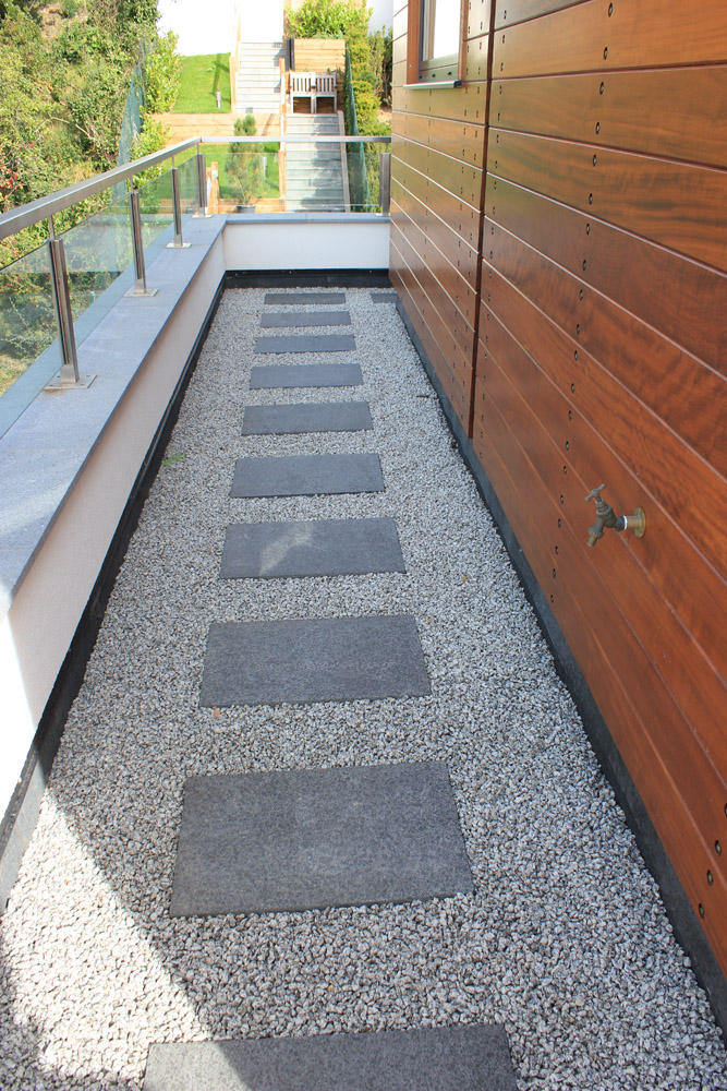 Silver grey granite aggregate 14mm with black basalt paving. Private property designed and built by Alan Carvosso. For further images of this job please visit our Projects-Private Places Gallery.