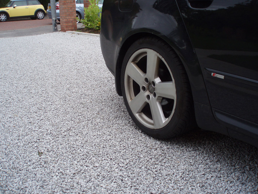 Silver grey granite aggregate laid in our gravel stabilisation system; Cedagravel®. Private driveway' in Ireland' designed by 22Over7 Architects and built by Barney Curren. For further images of this job please visit our Projects-Private Places Gallery.
